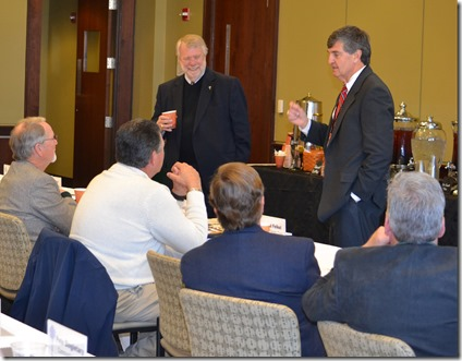 Spartanburg County Councilman David Britt (standing from right) and S.C. Commerce Secretary Bobby Hitt speak to a group of Berkeley County officials and economic development planners about BMW's startup and growth and the expected impact of Volvo. The session was arranged by the S.C. Department of Commerce. (Photo by Bill Poovey)