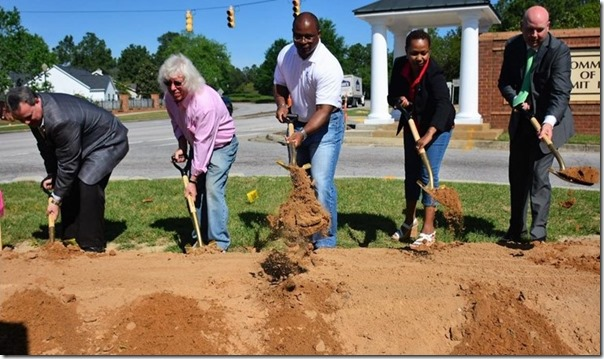 Richland Council County chairman Torrey Rush, center, joins council members Jim Manning and Julia-Ann Dixon at this morning's groundbreaking for a Transportation Penny Tax project in the Summit neighborhood. (Photo/Chuck Crumbo)