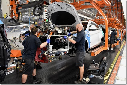 Members of the BMW Manufacturing Co. assembly team work on the 3.5 millionth BMW to roll off the Spartanburg County facility's production line. (Photo/Provided)