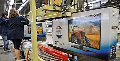 A box containing a 40-inch TV rolls off the assembly line at Element Electronic's assembly plant in Winnsboro. The manufacturer, which plans to grow its workforce to 500 employees, launched its S.C. operation in 2013 with the help of the Wal-Mart initiative. (Photo/Chuck Crumbo)