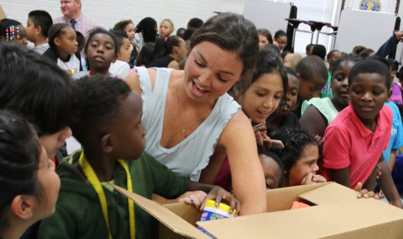 Teachers and kids at Taylor Elementary School in Cayce open boxes with some $10,000 worth of school supplies donated by Amazon. (Photo/Provided)