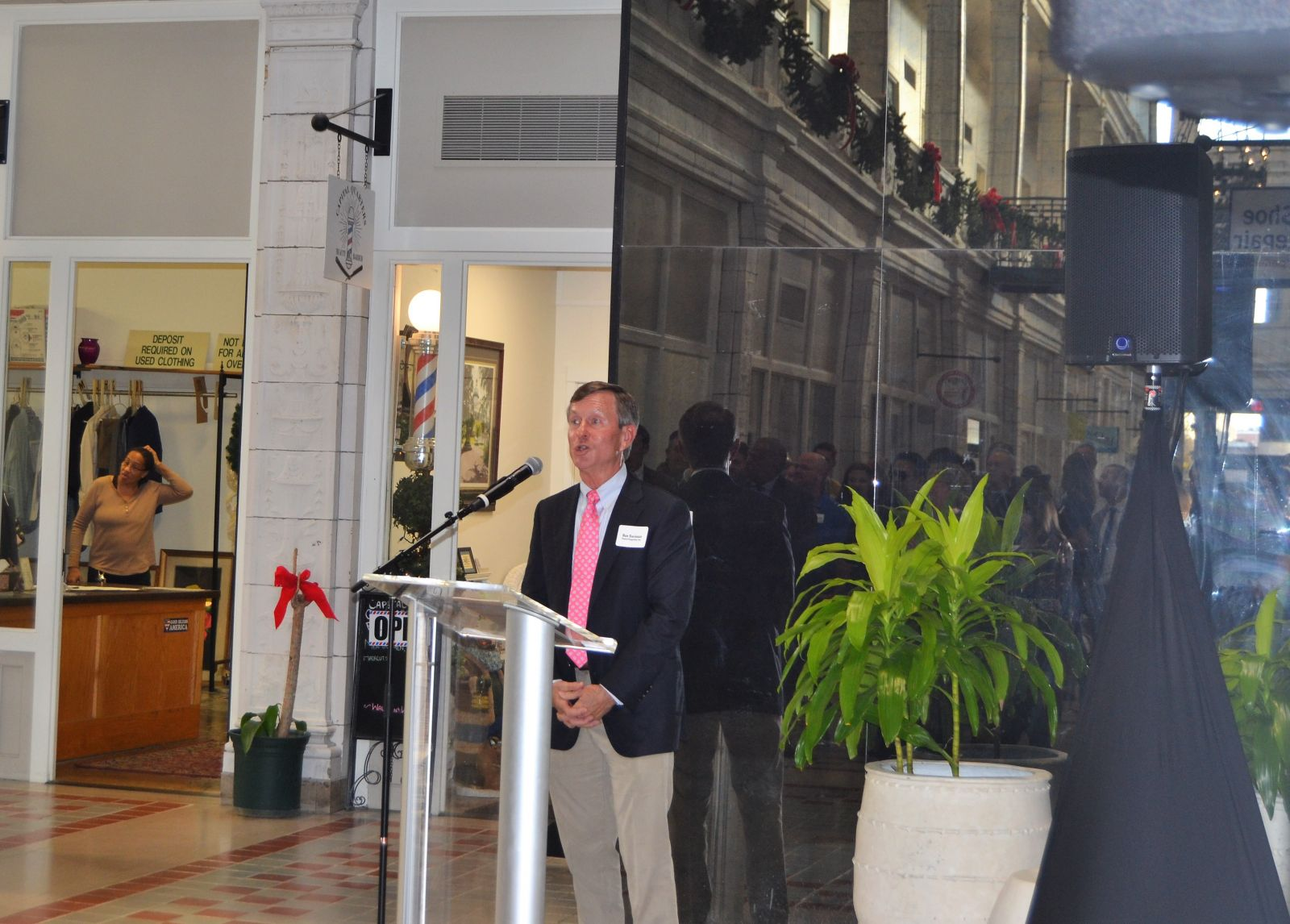 Developer and co-owner of the Arcade Mall Ron Swinson addresses a crowd at the building's re-grand opening celebration on Monday. (Photo/Melinda Waldrop)