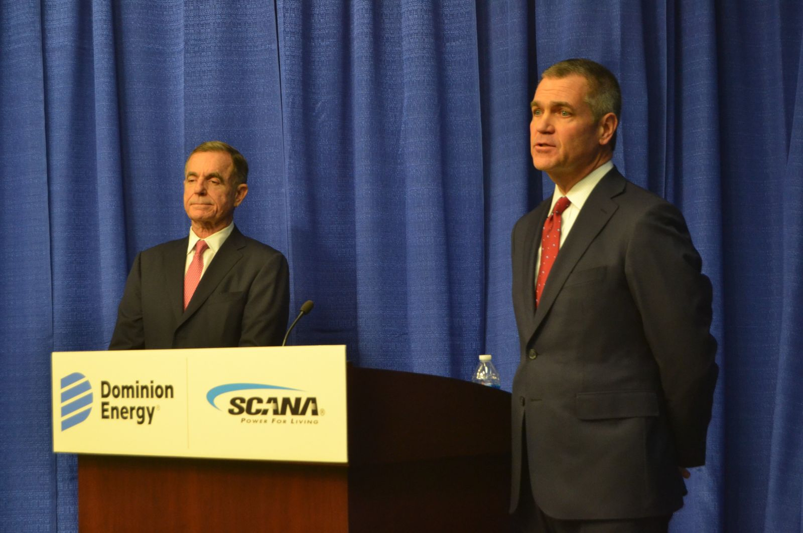 Dominion CEO Tom Farrell (left) and SCANA CEO Jimmy Addison discuss Dominion's proposed acquisition of SCANA. (Photo/Travis Boland)
