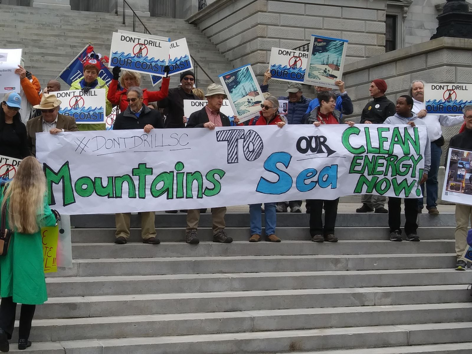 People rally at the Statehouse on Tuesday to oppose offshore drilling in South Carolina. (Photo/Travis Boland)