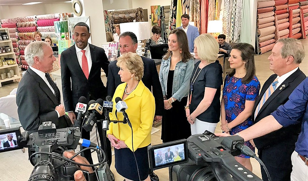 Linda McMahon, U.S. Small Business Adminstration administrator (in yellow), speaks with S.C. Gov. Henry McMaster during a tour of Forest Lake Fabrics, winner of the SBA's 2018 Phoenix Award. Forest Lake Fabrics owner Michael Marsha is standing behind McMahon. (Photo/SBA)