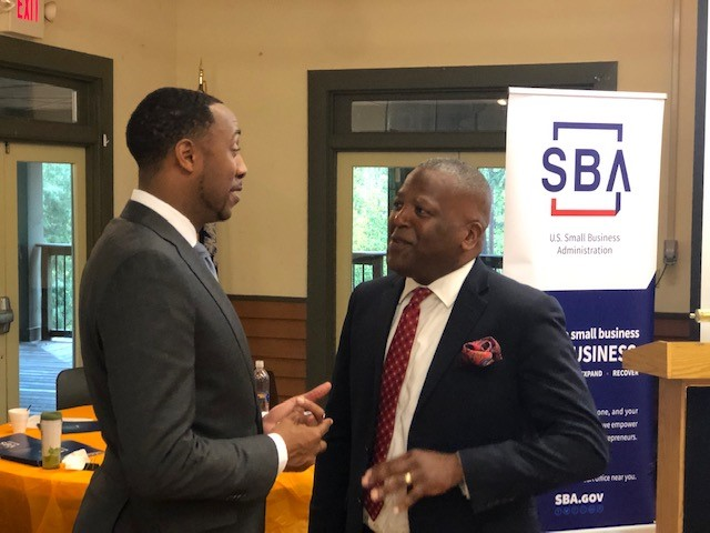SBA administrator Ashley Bell talks with Columbia Mayor Steve Benjamin. (Photo/Allen Brown/Columbia Small Business Development Center)