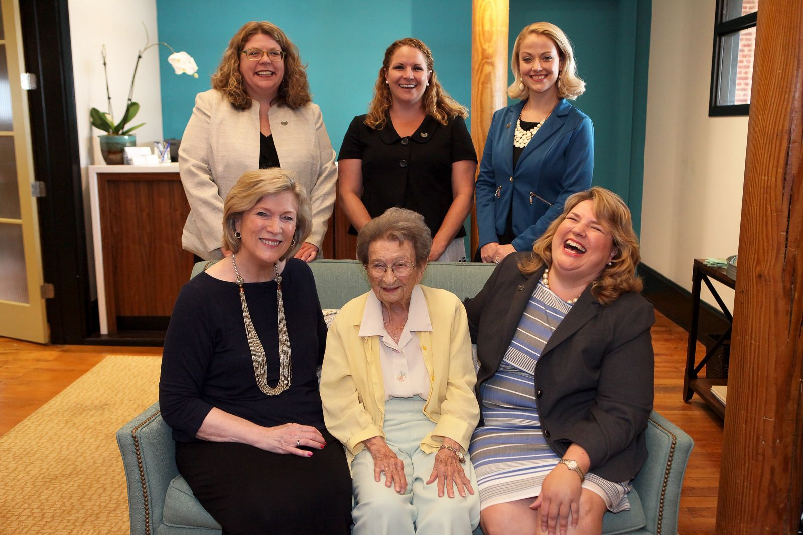 "Sarah Leverette (seated, center) visits the Vista law firm of Burnette Shutt & McDaniel P.A. Also pictured are Malissa Burnette (seated, left), Nekki Shutt (seated, right), Kathleen McDaniel (standing, from left), Janet Rhodes and Jacqueline ""Jax"" Pavlicek. (Photo/Courtesy of Molly Harrell Photography)"