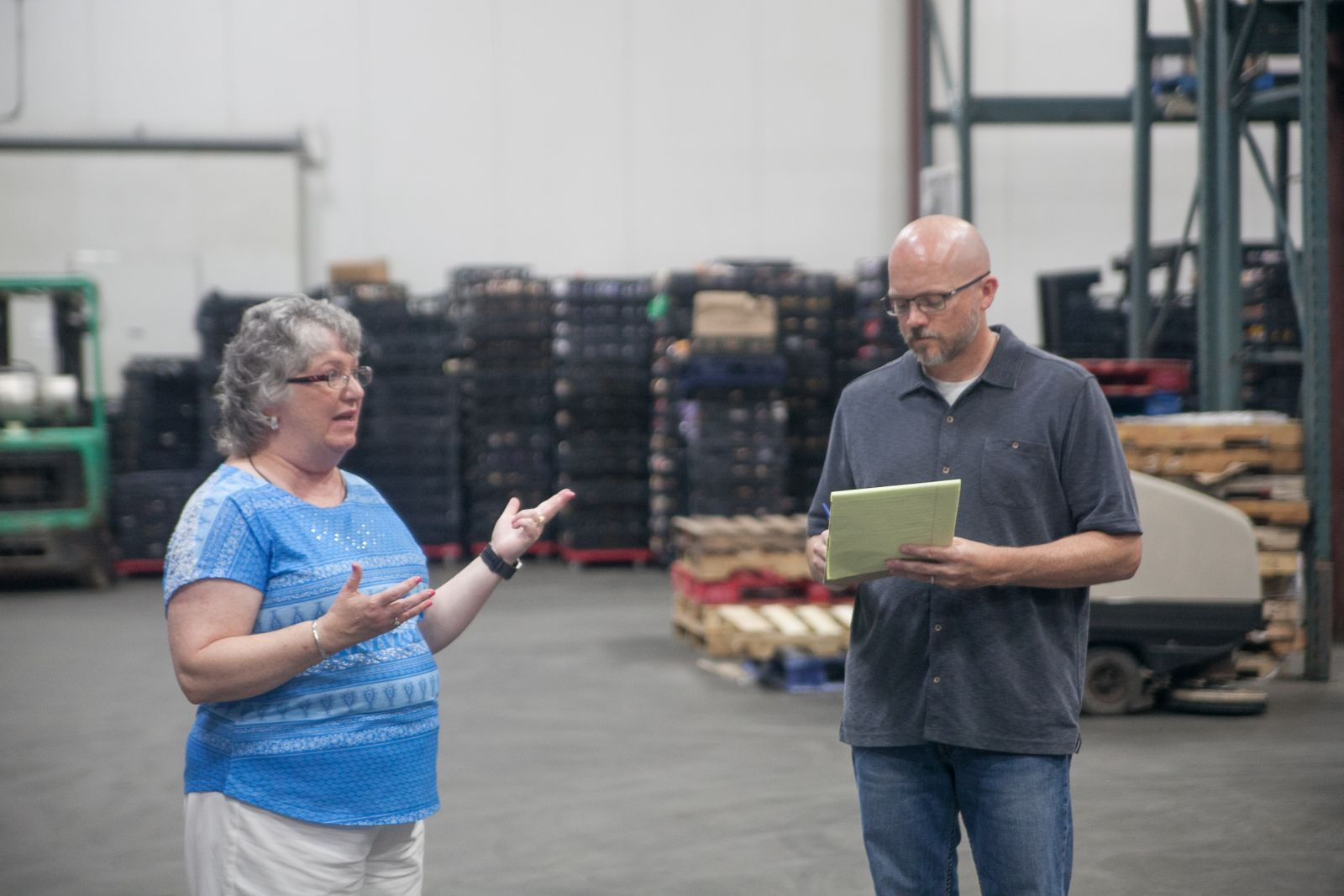 Harvest Hope CEO Denise Holland talks with Amazon's George Schultz.