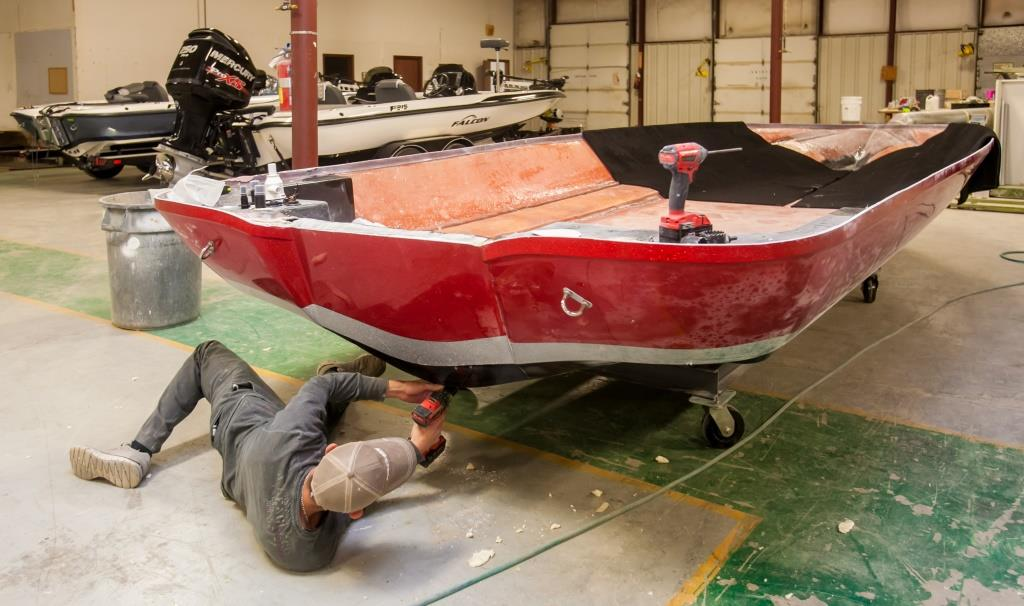 Falcon Boats employee Jonathan Gibson works on a boat in the company's factory in Newberry. (Photo/Jeff Blake)