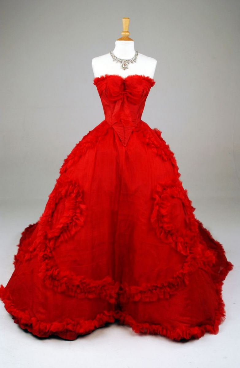 "A red silk taffeta gown worn by Lara Flynn Boyle in the 2006 film ""Land of the Blind."" (Photo/Provided)"