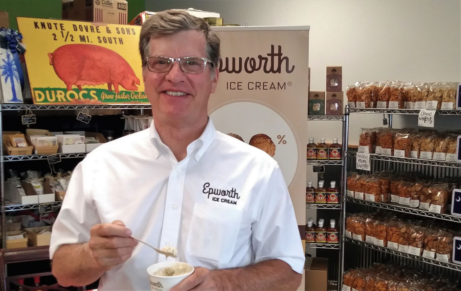 Dave Mackey, president of Epworth Ice Cream Co., takes a bite of peanut butter ice cream at Crave Market. (Photo/Travis Boland)