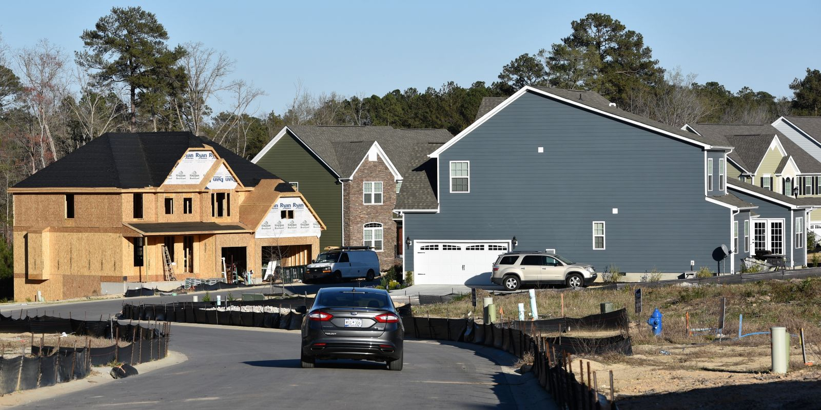 New homes are popping up around the Lexington area as builders try to keep up with housing demands. A motorist navigates Golden Fluke Drive where a home is nearing completion across the street from recently occupied residences.