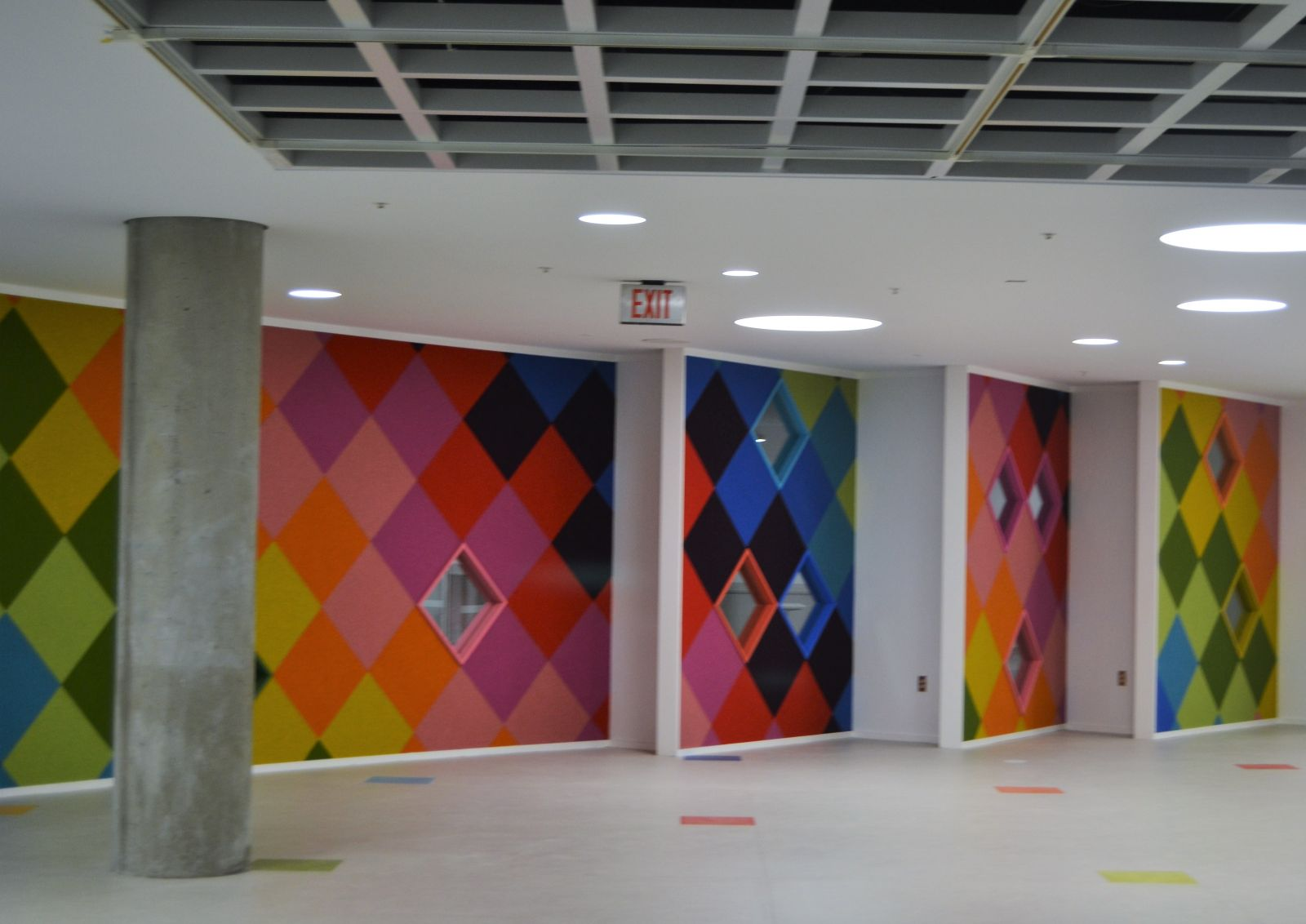 On the ground floor, colorfully patterned walls lead the way from an entrance connected to a parking lot to the new teen area. (Photo/Melinda Waldrop)