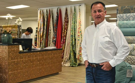 Michael Marsha rebuilt Forest Lake Fabrics with the help of friends. (Photo/Chuck Crumbo)