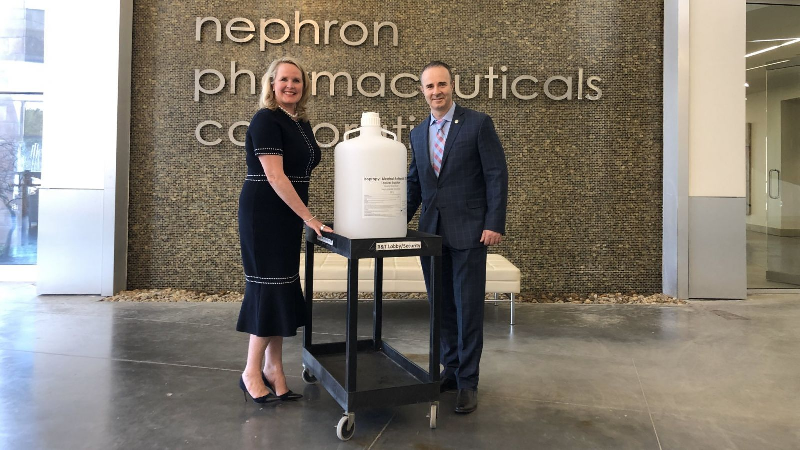 Nephron president and CEO Lou Kennedy (left) donated 50 liters of hand sanitizer made at the West Columbia respiratory medication manufacturer to the William Jennings Bryan Dorn Veterans Affairs Medical Center. (Photo/Provided)
