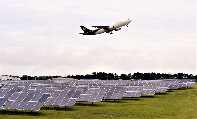A UPS cargo plane takes off this morning over a new solar farm at Columbia Metropolitan Airport. The installation is the first airfield solar farm in South Carolina. (Photo/Travis Boland)