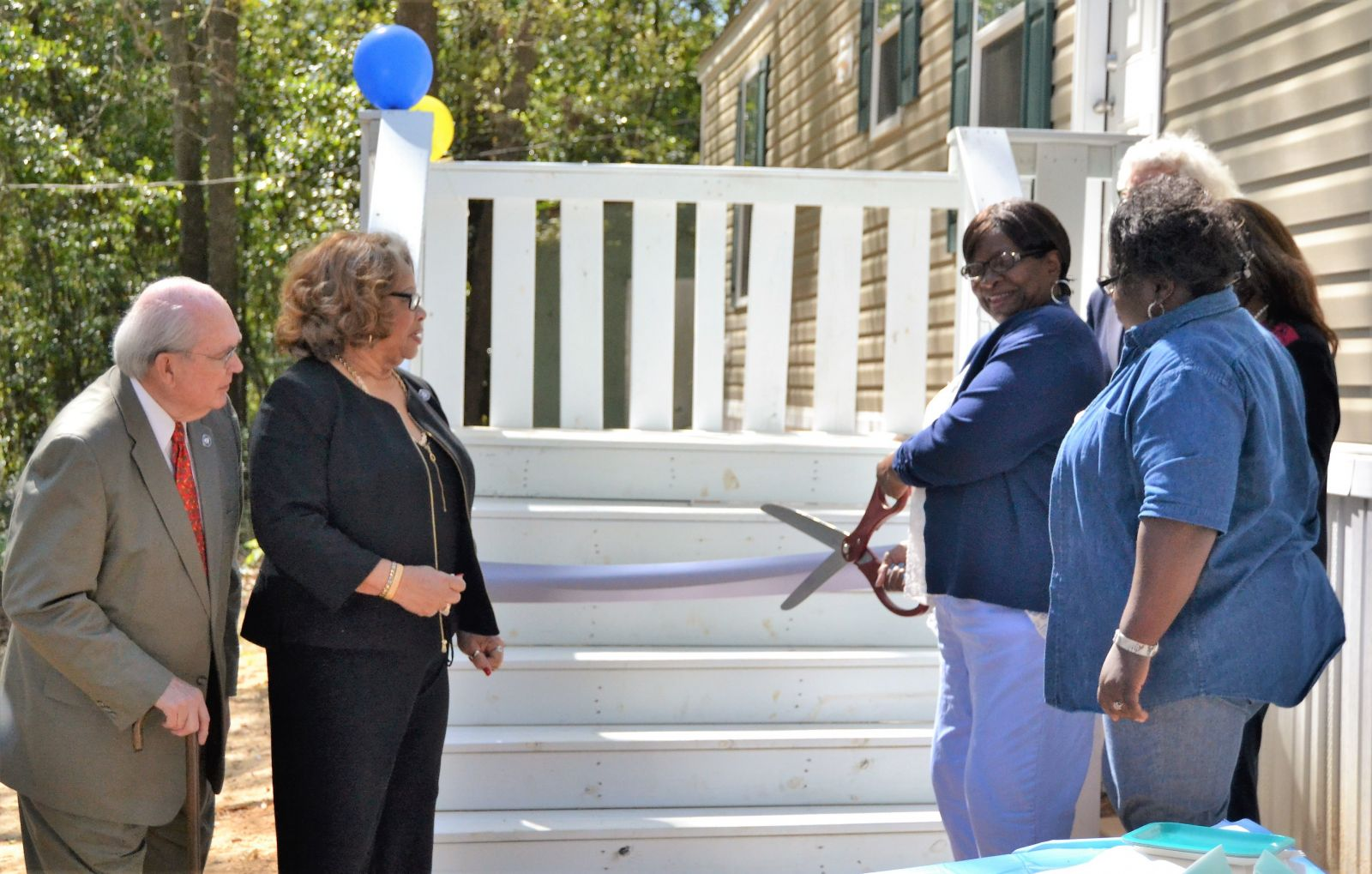 Judith Spry cuts the ribbon on her new home. She is joined by Richland County Council chairwoman Joyce Dickerson along with council members Greg Pearce, Yvonne McBride and Jim Manning. (Photo/Travis Boland)