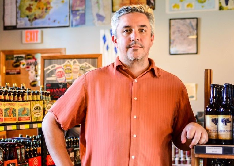 Vino Garage owner Doug Aylard, who relocated his wine shop last fall, says business is continuing at about the same pace as before, though he's had to shift his business model to a 100% retail focus. (Photo/File)