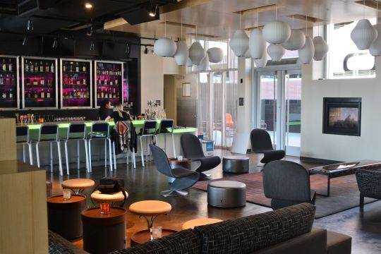 The WXYZ Bar anchors the lobby of the Aloft Hotel, which recently opened in the Vista. The bar, which feels more like a social club, has a pool table, outdoor seating and live music. (Photo/Travis Boland)